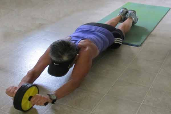 man performing ab roller exercise